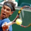 Nadal reaches quarters, milestone
