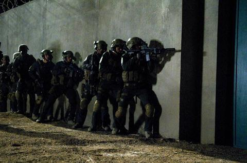 "Courtesy AFP: This still photo from ""SEAL Team Six: The Killing of Osama bin Laden"" shows a dramatization of the night raid on the Al-Qaeda leader's hideout in Abbottabad."