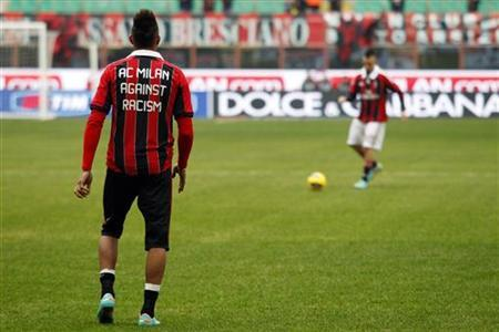 AC Milan's Boateng, wearing a jersey against racism, and El Shaarawy warm up before their Serie A soccer match against Siena at San Siro stadium in Milan