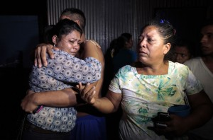Residents living in a building react after a magnitude 6.1 earthquake shook western Nicaragua