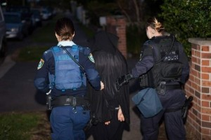 A women policers detaining a woman