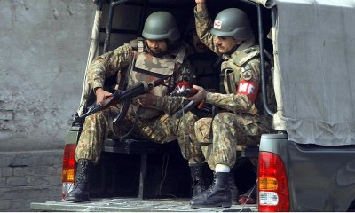Army personnel arrive at the site of TTP attack on Army Public School situated on Warsak Road - INP Photo