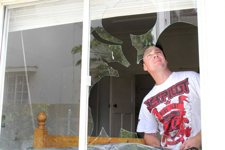 Kane Collier, from West End in Brisbane, whose flat was affected by the super storm that swept over Brisbane. ABC News: Giulio Saggin