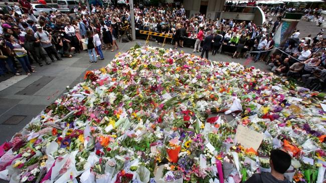 The growing mass of flowers at the Martin Place memorial.