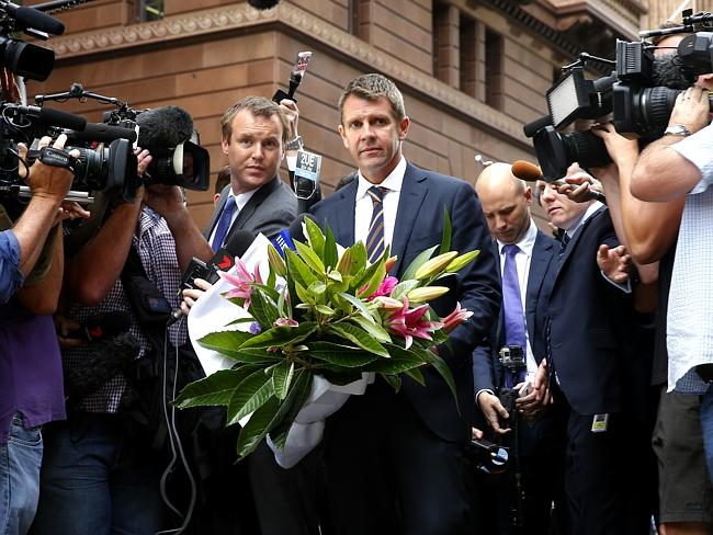 Premier Mike Baird pays his respects at the memorial in Martin Place. Photo: Bradley Hunter