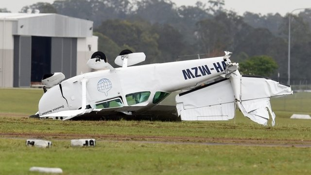 A light plane is badly damaged at Archerfield aerodrome in Brisbane's south. Photograph by Dan Peled/AAP