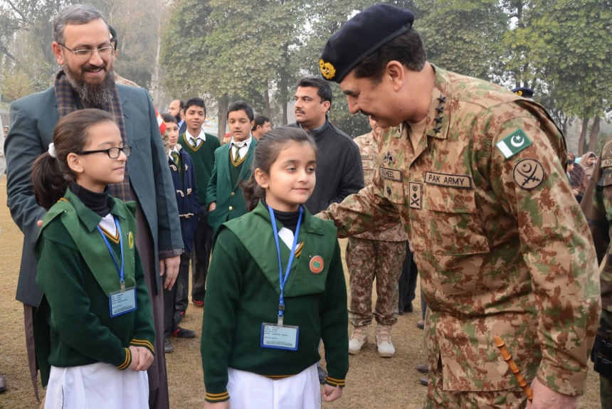 Army chief Raheel Sharif speaks with students at Peshawar Army Public School that reopened on January 12.  Photograph: AFP/Getty Images