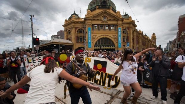 Hundreds of Invasion Day protestors march at the back of the Australian Day Parade in Melbourne's CBD. Photo: Jason South