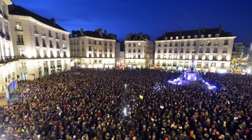 People gather at the Place Royale in Nantes, France, after the attack in Paris (Georges Gobet - AFP - Getty Images)
