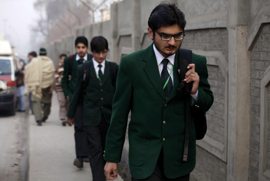 Schoolchildren arriving at the Army Public School. Photo: Arshad Arbab/EPA