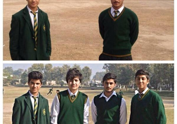 Two students of Peshawar school recreate a photo without their friends who lost lives in the terrorist attack on 16 Dec. 2014 on their school killing more than 140 children.
