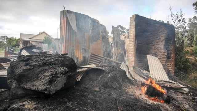 A photo taken on January 4 shows the burnt out remains of a property in the Adelaide Hills district of Gumeracha.