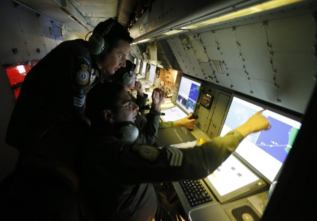 Radar specialists are pictured aboard a Royal New Zealand Air Force P-3K2 Orion aircraft searching for missing Malaysian Airlines flight MH370 over the southern Indian Ocean. (Reuters/Jason Reed)