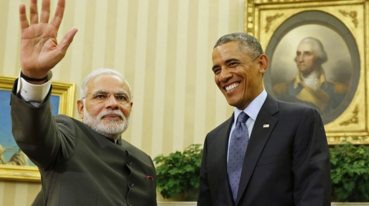 U.S. President Barack Obama smiles Tuesday as he hosts a meeting with Indian Prime Minister Narendra Modi in the Oval Office of the White House.   REUTERS
