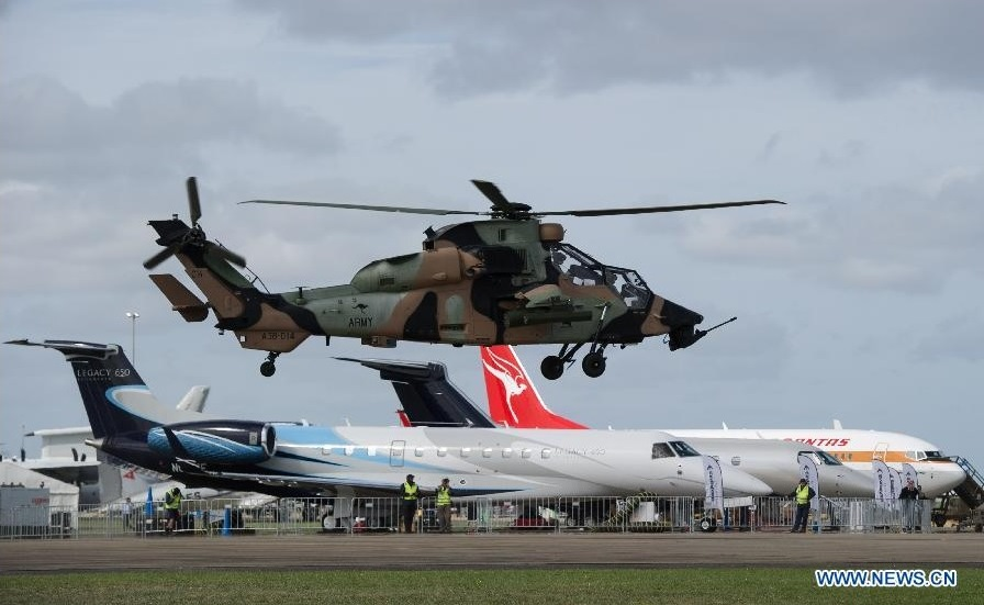 A Royal Australian Army Tiger helicopter lands after performing at the Australian International Airshow on the Industry Expo day at the Avalon Airfield, southwest of Melbourne, Australia, Feb. 24, 2015. (Xinhua/Bai Xue)