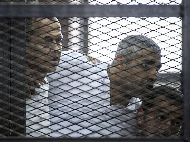 Imprisoned ... Australian journalist Peter Greste (left) and his colleagues, Egyptian-Canadian Mohamed Fadel Fahmy and Egyptian Baher Mohamed, at the police institute near Cairo's Tora prison on June 23, 2014. Picture: AFP/Khaled Desouki Source: AFP