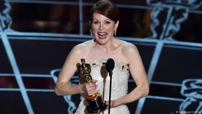 Fourth time lucky: Julianne Moore collects the Best Actress award