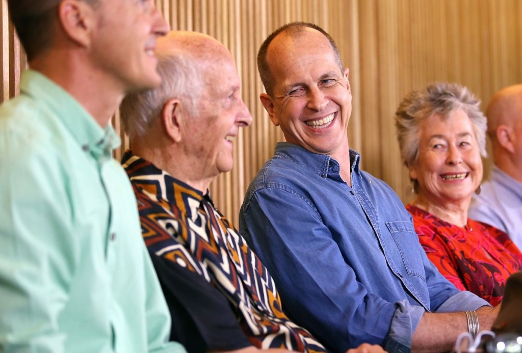 Australian journalist Peter Greste (2nd R) smiles as he sits next to his mother Lois (R) and father Juris (L) during a media conference in Brisbane February 5, 2015. Photo: Reuters/Nathan Richter