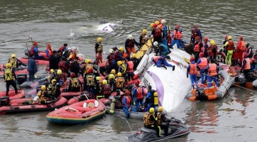 Rescue operations were underway on Wednesday to retrieve passengers from a TransAsia Airways flight that crashed into a river in Taiwan. Credit Pichi Chuang/Reuters