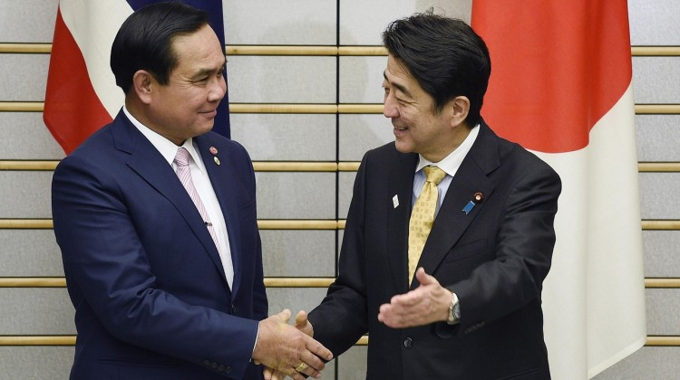 Thailand PM Gen. Prayuth Chan-ocha, left, and Japanese Prime Minister Shinzo Abe shake hands before their meeting at Mr. Abe's official residence in Tokyo on Monday. Photo: Reuters