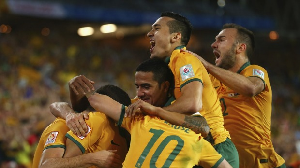 Tim Cahill, Jason Davidson and Ivan Franjic of Australia celebrate after Massimo Luongo of Australia scored. Photo: Getty Images