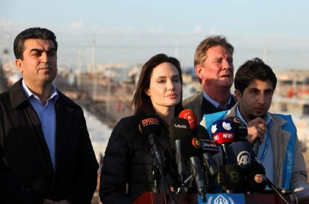 US actress and UNHCR ambassador Angelina Jolie delivers a speech during a visit to a camp for displaced Iraqis in Khanke, a few kilometres (miles) from the Turkish border in Iraq's Dohuk province, on January 25, 2015.