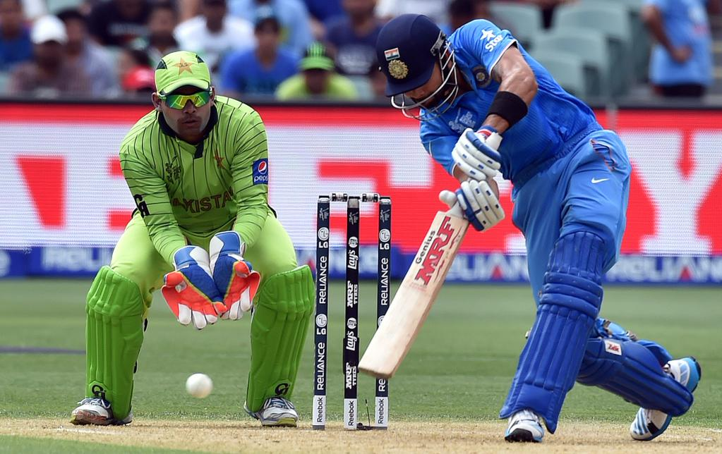 India's Virat kohli drives a ball during the high-voltage match against Pakistan at Adelaide in the fourth match of the World Cup 2015. Photo: ICC
