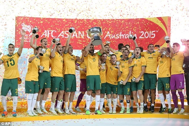 The Socceroos celebrate with the Asian Cup trophy after beating South Korea 2-1 in the final at Stadium Australia on January 31, 2015 in Sydney.