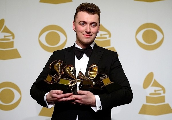 Sam Smith poses with his awards for Best New Artist, Best Pop/Vocal Album, Song of the Year and Record of the Year.