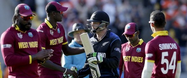 Martin Guptill shakes hands with West Indies captain Jason Holder. Photo: Reuters