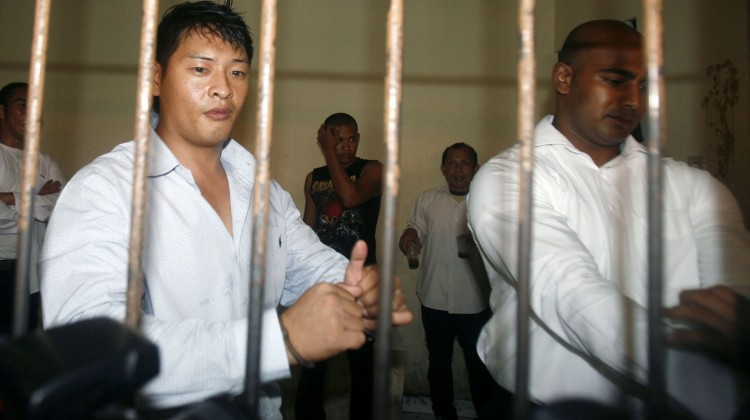 Australian Andrew Chan and Myuran Sukumaran waiting in a temporary cell for their appeal hearing in Denpasar District Court in Indonesia's resort island of Bali. Photo: Reuters