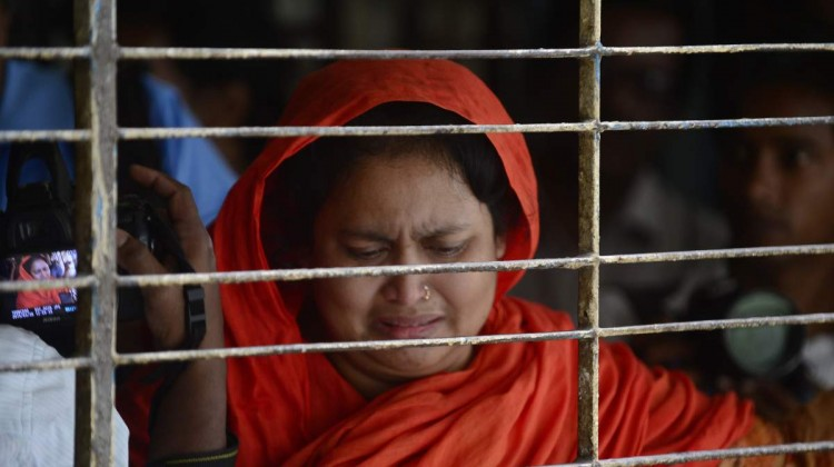 A relative of dead Bangladeshi blogger Washiqur Rahman reacts after seeing his body at Dhaka Medical College in Dhaka on March 30, 2015, after he was killed in an attack in the Bangladeshi capital. Photo: Munir Uz Zaman -AFP/Getty Images