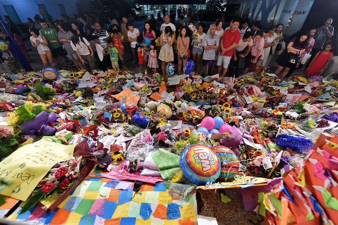 Flowers, messages and other tributes are piling up outside the hospital where Lee Kuan Yew died