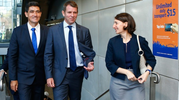 NSW Premier Mike Baird, Parramatta MP Geoff Lee and NSW Minister for Transport Gladys Berejiklian leave Parramatta Station after announcing new transport measures. Photo: Daniel Munoz
