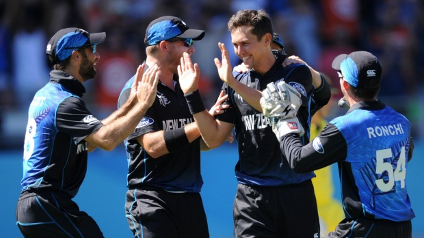 New Zealand's Trent Boult is congratulated by teammates after removing Mitchell Marsh, one of the Black Caps fast bowler's five scalps. Photo: AP