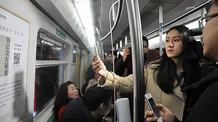 On Beijing's subway, commuters usually spend their rides mindlessly staring at their phones