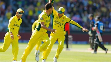 Australia celebrates after taking early wickets during the Cricket World Cup final in Melbourne, Australia.