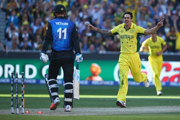 Australia's Mitchell Johnson, right, celebrates after taking the wicket of New Zealand's Daniel Vettori, left, during the Cricket World Cup final in Melbourne, Australia.