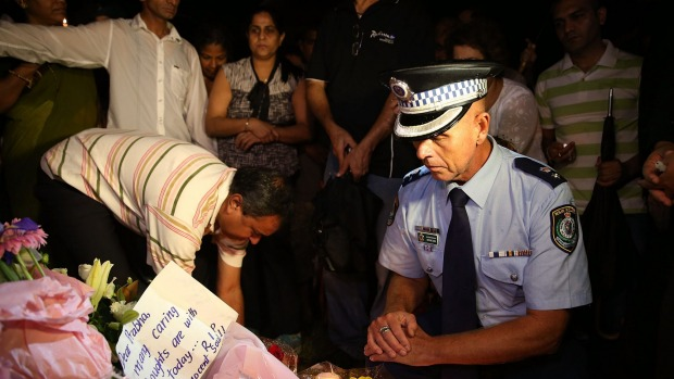Police Superintendent Wayne Cox pays his respects at a memorial site for stabbing victim Prabha Arun Kumar at Parramatta on Wednesday. Photo: Brendon Thorne