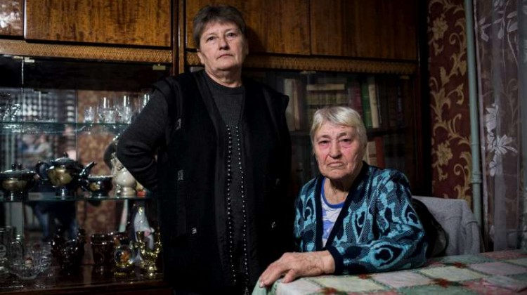 Larissa Riabseva, aged 81, and her 62-year-old daughter Elena in their temporary home in Mariupol, Ukraine. The two women fled their large house in Shyrokyno, a town on the Azov Sea, when it came under attack. She had lived there all her life. Photo by UNHCR/A.McConnell