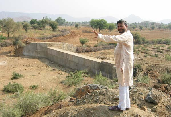 Rajendra Singh, India's water man besides a check dam in Rajhistan, India.