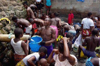 Residents crowd for water at the only standpipe in Mabella slum in Sierra Leone's capital Freetown. Photo: Katrina Manson/Reuters