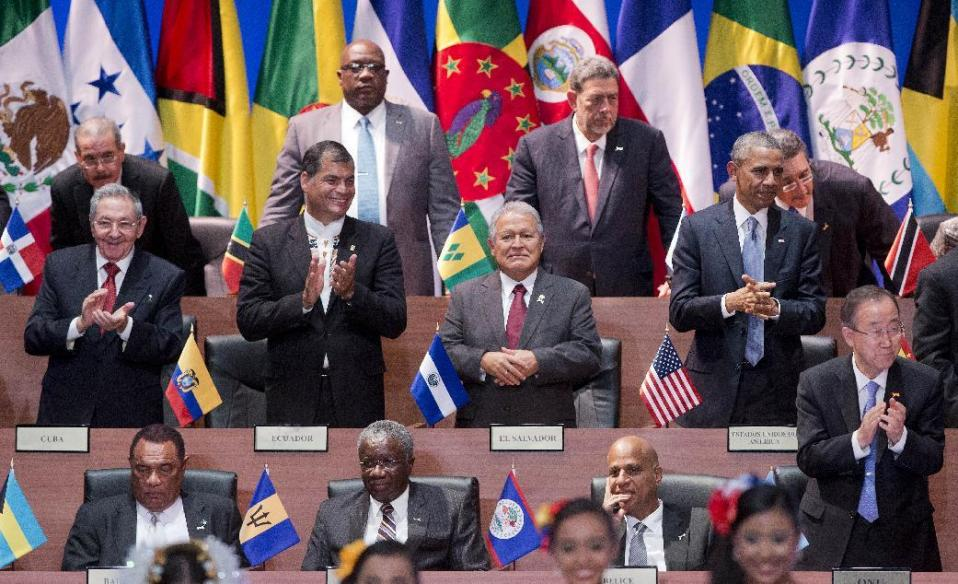 US President Barack Obama, right middle row, and Cuban President Raul Castro, left middle row, and other World Leaders applaud during the inauguration ceremony of the Summit of the Americas arrival ceremony in Panama City, Panama. Photo: AP/Pablo Martinez Monsivais