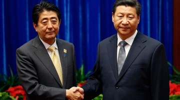 China's President Xi Jinping (right) greets Japan's Prime Minister Shinzo Abe.