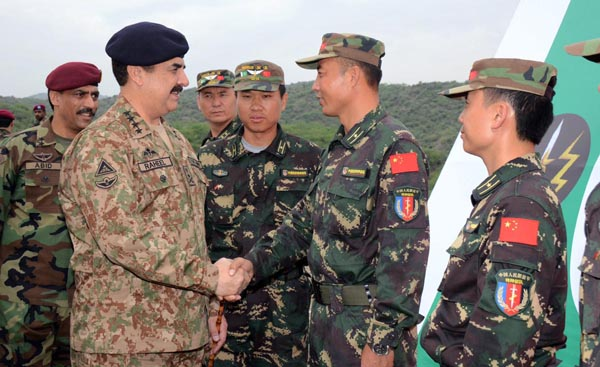 Chief of Army Staff General Raheel Sharif meeting a Chinese soldier during his visit to Pak-China special forces joint training exercise at Headquaters SSG near Cherat, Pakistan.