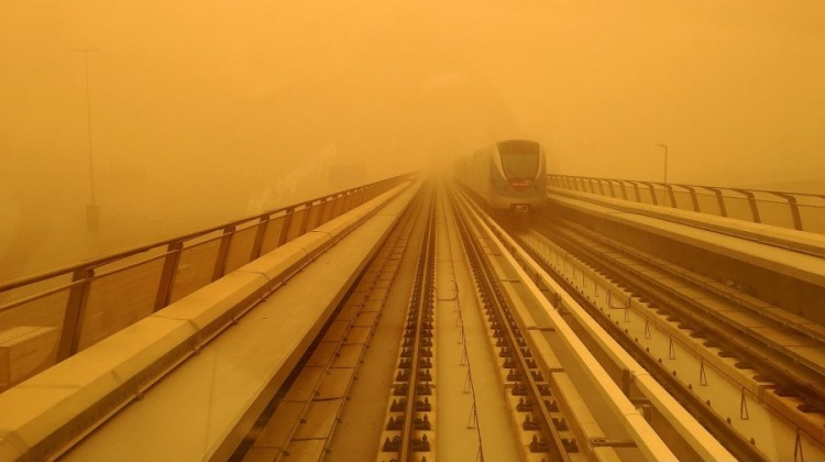 A Dubai metro train is seen driving amid a sandstorm that engulfed the city on April 2, 2015. (Marwan Naamani/AFP/Getty Images)