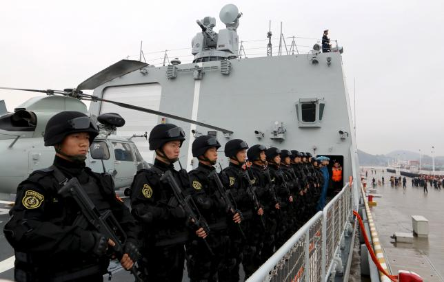 Soldiers of Chinese People's Liberation Army stand on deck before the fleet sets out for Aden, Yemen from Zhoushan. Photo: Reuters/Stringer