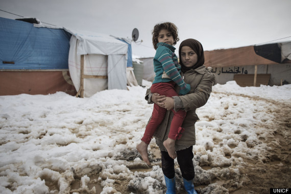 Syrian Sisters Rimas, 3, (L) and Suraya, 6, (R) from Aleppo brave winter in Lebanon, Bekaa Valley. Photo: Alessio Romenzi
