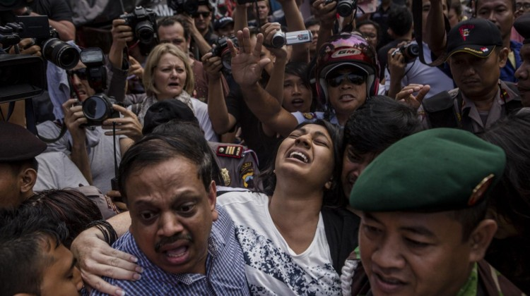 Brintha Sukumaran (C), a sister of Australian death row prisoner Myuran Sukumaran's screams as she arrives at Wijaya Pura port to visit her brother at Nusakambangan prison ahead of the executions of the Bali 9 in Cilacap, Central Java, Indonesia. Photo: Ulet Ifansasti/Getty Images