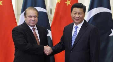 Pakistan's Prime Minister Nawaz Sharif shakes hands with China's President Xi Jinping. Photo: Reuters